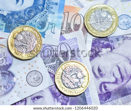 Close up of British Currency in Paper and Polymer Notes and Gold and Silver Coins #1206446020