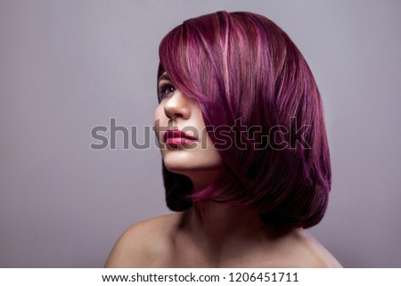 Portrait of beautiful fashion model woman with short purple colored hairstyle and makeup and looking away. indoor studio shot, isolated on gray background. #1206451711