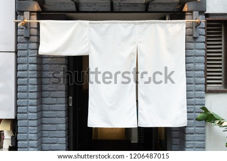 The curtain-like fabric that hangs in front of traditional Japanese restaurants and shops not only serves as a signboard, but holds a larger meaning,