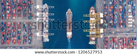 Aerial view panoramic oil tanker moving pass sea port warehouse and container ship or crane ship working for delivery containers shipment.  Royalty-Free Stock Photo #1206527953