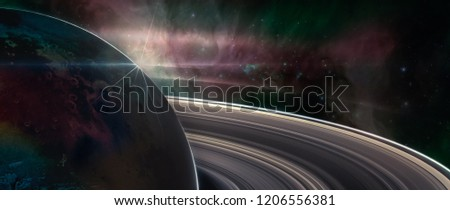 Saturn planet with rings in outer space, with galaxy background,  Elements of this image furnished by NASA.