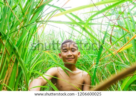 Rural children are enjoying the rice field. #1206600025