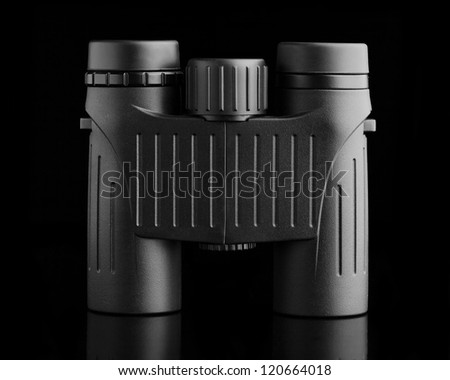 Modern compact binoculars over black background #120664018