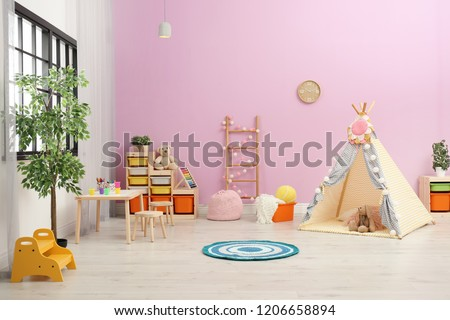 Modern nursery room interior with play tent for kids #1206658894