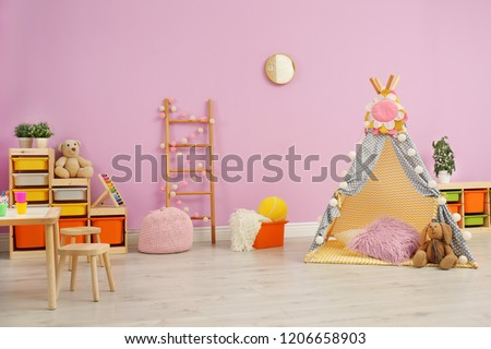 Modern nursery room interior with play tent for kids #1206658903