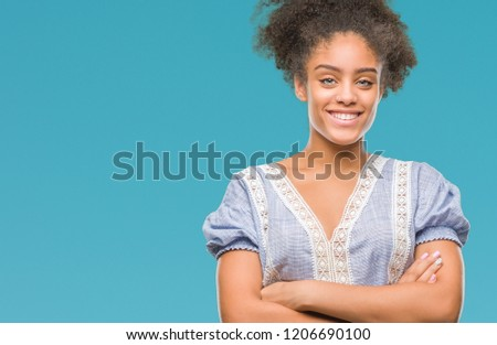 Young afro american woman over isolated background happy face smiling with crossed arms looking at the camera. Positive person. #1206690100
