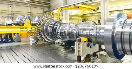 assembling and constructing gas turbines in a modern industrial factory Royalty-Free Stock Photo #1206768199