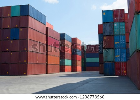 Container depot service with truck, reach stacker and shipping containers on yard at background. #1206773560