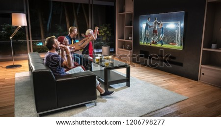 Group of fans are watching a soccer moment on the TV and celebrating a goal, sitting on the couch in the living room. The living room is made in 3D. #1206798277