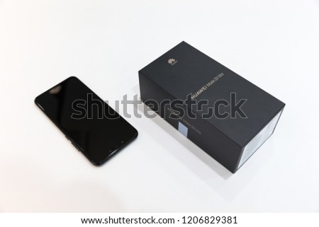 Belgrade, Serbia - October 03, 2018: Huawei Mate 20 Lite mobile smartphone is displayed with original box on isolated white background. #1206829381
