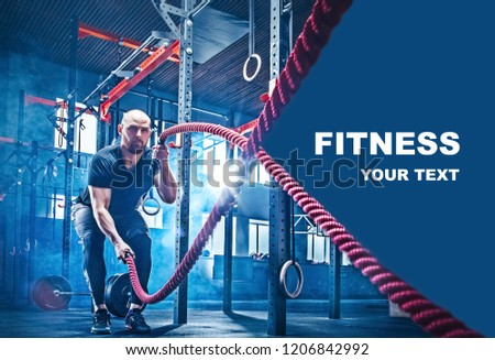 Men with battle rope battle ropes exercise in the fitness gym. CrossFit concept. gym, sport, rope, training, athlete, workout, exercises concept #1206842992