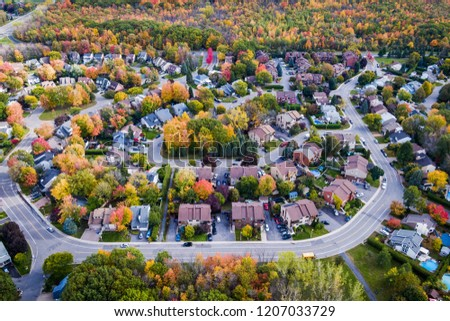Residential neighbourhood in the suburbs of Montreal during autumn season in Quebec, Canada, aerial view.  Royalty-Free Stock Photo #1207033729