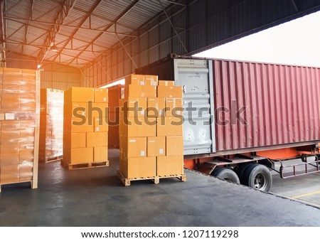 Logistic and warehouse courier shipment transportation the shipment pallet at docks distribution warehouse with container truck. #1207119298