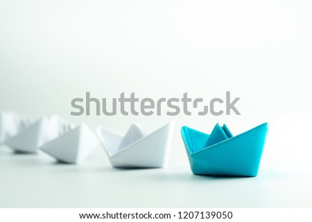 Leadership and Success concept with Blue paper ship leading a white paper ships. #1207139050