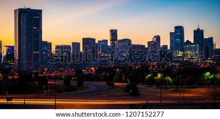 Morning Sunrise in the Mile High City of Denver , Colorado , USA golden hour Traffic and gorgeous sunshine panoramic panorama entire horizon skyline cityscape time lapse golden hour