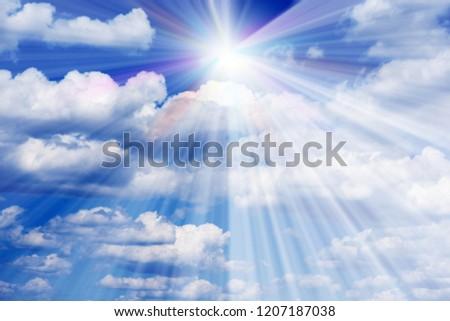 Sunburst through the haze on blue sky