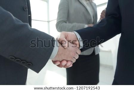 Close up business man handshake together on meeting room #1207192543