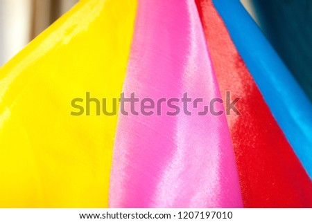 Beautiful bright multicolored silk fabric folded. Colorful background wallpaper. #1207197010