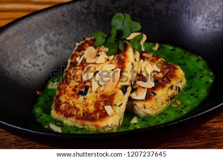 Tofu cutlet with sauce and nuts #1207237645