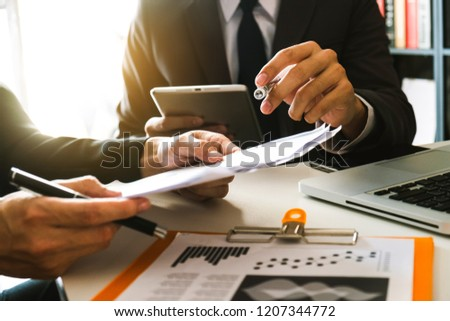 Two business meeting professional investor  working together with smart phone and laptop and digital tablet computer in office space  #1207344772
