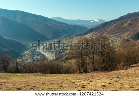 Early spring Carpathian mountains plateau landscape with snow-covered ridge tops in far, Ukraine. #1207421524