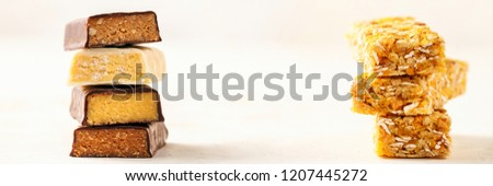 Different Energy protein bars and oatmeal bars on light background.   Set of energy, sport, breakfast and protein bars. Copy space. Banner #1207445272