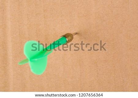 Green darts on yellow cardboard #1207656364