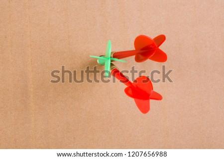 Three darts on yellow cardboard #1207656988