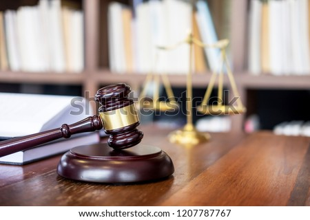 Wooden judges gavel on wooden table on light background, justice Law concept close up in a courtroom or enforcement office  #1207787767