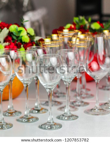 wine glasses on the table for drinks (close-up partial view). Festive crystal  #1207853782