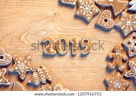 Merry Christmas and Happy new year! Homemade ginger cookies on wooden table. Copy space for your text. Top view. Christmas baking concept #1207916755