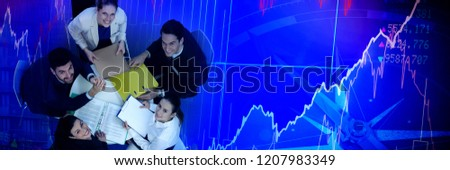High angle portrait of business people sitting at table against high angle view of crowded buildings in city #1207983349