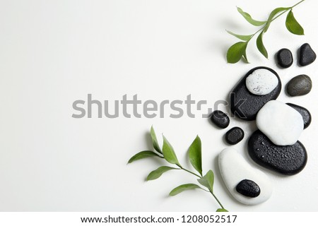 Flat lay composition with spa stones and space for text on white background #1208052517