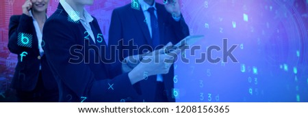 Businesswoman using tablet while colleagues talking on phone in background against server rack against sky and cloud background #1208156365