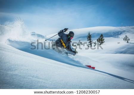 Skier enjoying a deep powder turn #1208230057