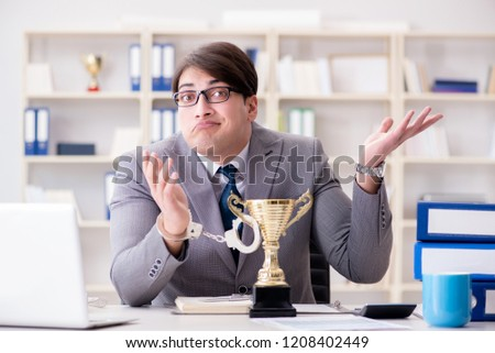 Businessman with golden cup in the office #1208402449