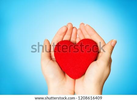 Love shape exercise ball on female woman #1208616409