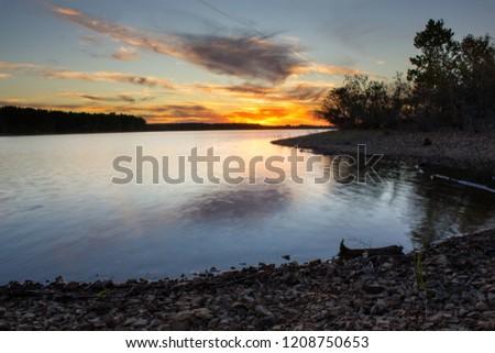 Beautiful sunset on fellows lake in Springfield Missouri. #1208750653
