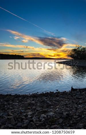Beautiful sunset over fellows lake in Springfield Missouri, Verticle #1208750659