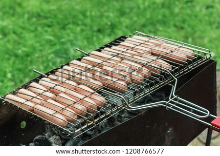 BBQ. Meat and sausages fried on a fire #1208766577