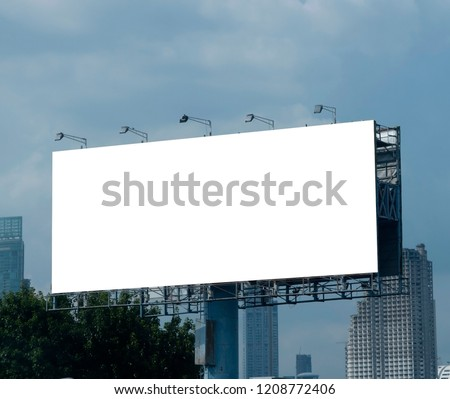 Blank billboard on blue sky background for new advertisement #1208772406
