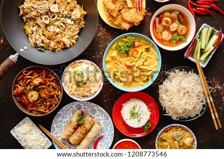 Asian oriental food composition in colorful dishware, served on dark rustic background, top view. Chinese, vietnamese, thai cuisine set. With copy space. #1208773546