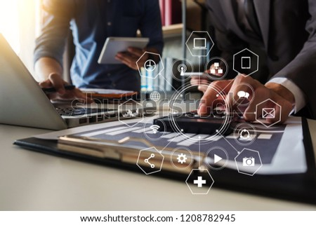 Business team meeting present.professional investor working with new startup project. Finance managers task.Digital tablet laptop computer design smart phone in morning light. #1208782945