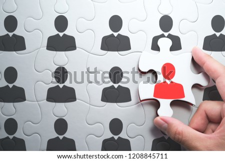 Selecting right people for organization's success. Human resource management and selecting leader concept. Putting last jigsaw puzzle piece with red businessperson. #1208845711