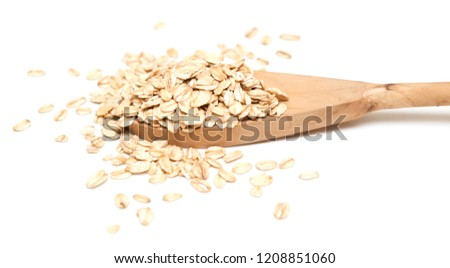 Oat flakes with wooden spoon on white background #1208851060