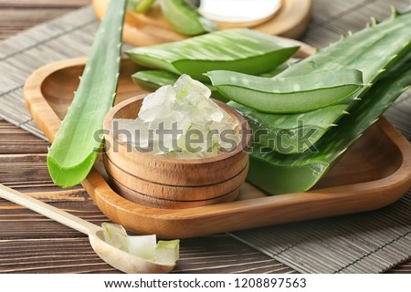 Bowl with aloe vera on wooden tray #1208897563