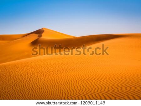 Amazing view of sand dunes in the Sahara Desert. Location: Sahara Desert, Merzouga, Morocco. Artistic picture. Beauty world. #1209011149