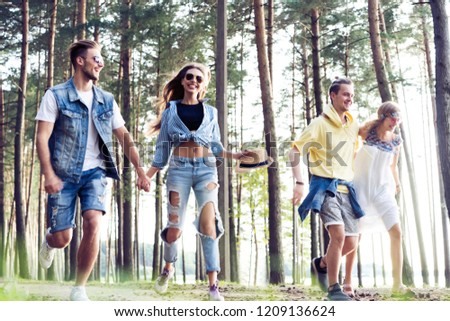 Carefree weekend with friends. Couple in love enjoying a walk on a sunny day. #1209136624