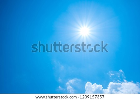 Beautiful summer background with sunlight and clouds on blue sky. #1209157357