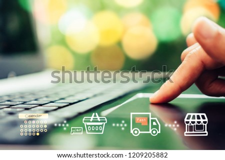 Women hand using smartphone do shopping online store with various doodle icons pop up. Social media maketing concept. #1209205882